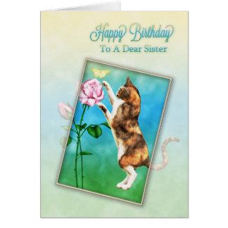 Hermana, feliz cumpleaños con un gato juguetón tarjeta de felicitación