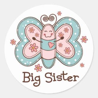 Hermana grande de la mariposa pegatina redonda