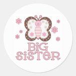 Hermana grande de la mariposa rosada etiqueta