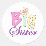Hermana grande (flor) etiqueta redonda