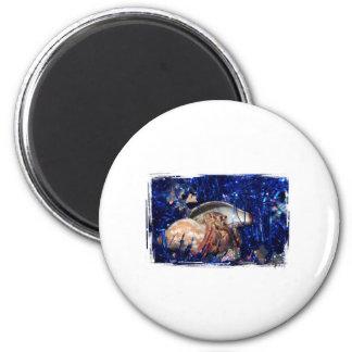 Hermit Crab Christmas Design Against Blue Tinsel Magnet