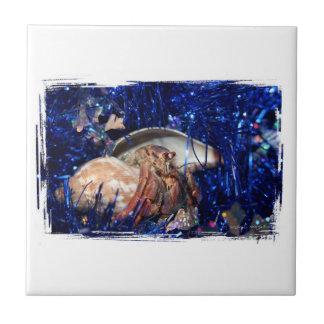 Hermit Crab Christmas Design Against Blue Tinsel Ceramic Tile