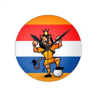 Héroe anaranjado del fútbol del león reloj redondo mediano