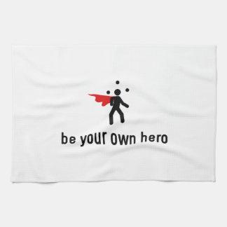 Héroe que hace juegos malabares toallas de mano