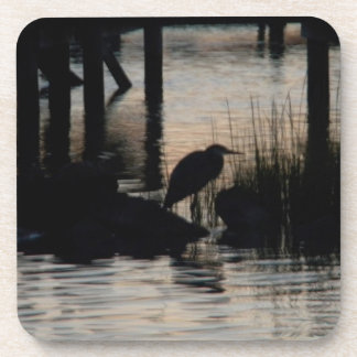 Heron Silhouetted on water at sunset Drink Coaster