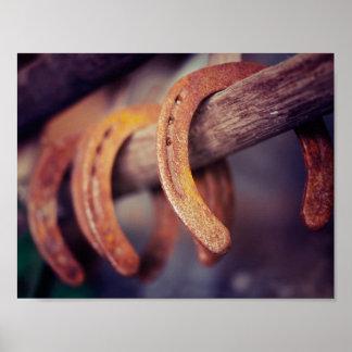 Herraduras en el país de madera del vaquero del póster