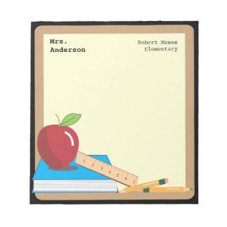 Herramientas pizarra de los profesores y libreta d blocs