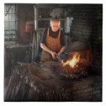 Herrero - los herreros tienen gusto de él caliente teja  ceramica
