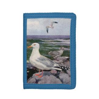 Herring Gulls on Rocky Shoreline Tri-fold Wallet