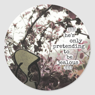 he's only pretending to be jealous classic round sticker