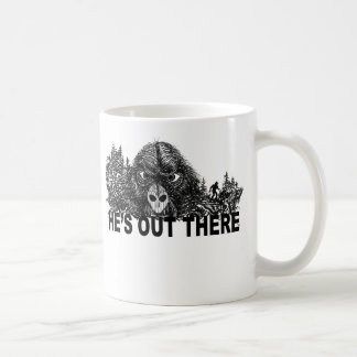 HEs OUT THERE coffee mug