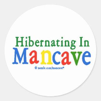 Hibernating in Mancave Sticker
