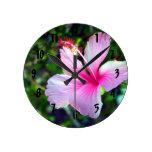 Hibiscus flower bright pink against green round wallclocks
