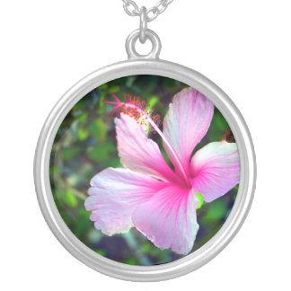 Hibiscus flower bright pink against green round pendant necklace