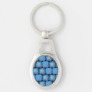 Hibiscus in blue gel Silver-Colored oval metal keychain