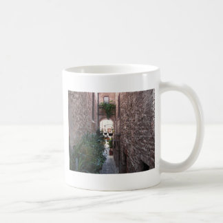 Hidden alley in old village of Spello, Italy Coffee Mug