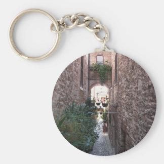 Hidden alley in old village of Spello, Italy Keychain