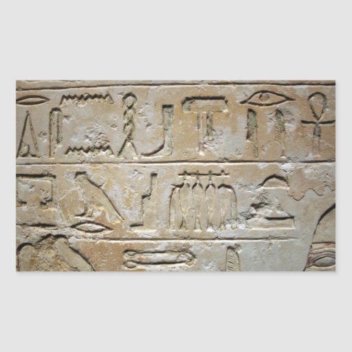 Hieroglyphics en una pared de piedra rectangular altavoces