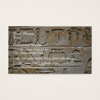 Hieroglyphics on a stone wall business card