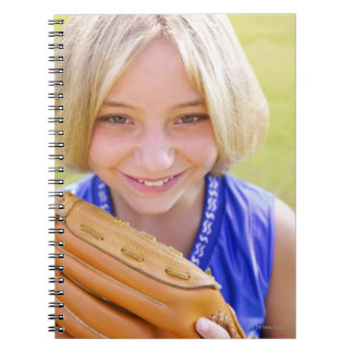 High angle portrait of a softball player smiling note book