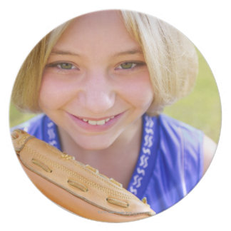 High angle portrait of a softball player smiling dinner plates