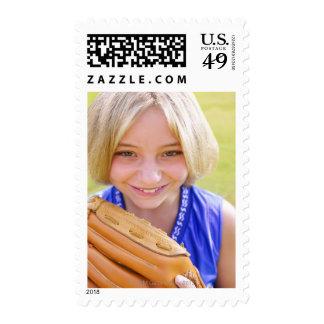 High angle portrait of a softball player smiling stamp