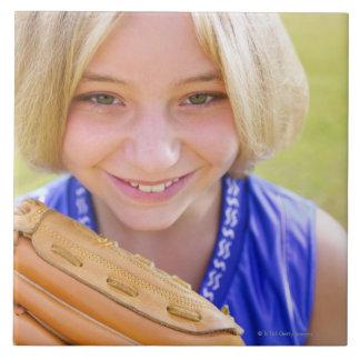 High angle portrait of a softball player smiling tile