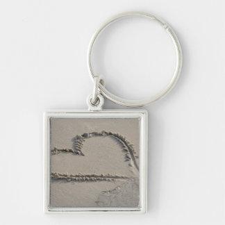 High angle view of a heart shape on the beach keychain