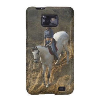 High angle view of a young woman riding a horse samsung galaxy s2 cover