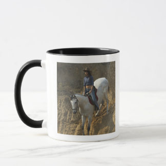 High angle view of a young woman riding a horse mug