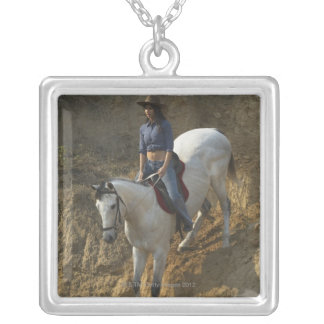 High angle view of a young woman riding a horse personalized necklace
