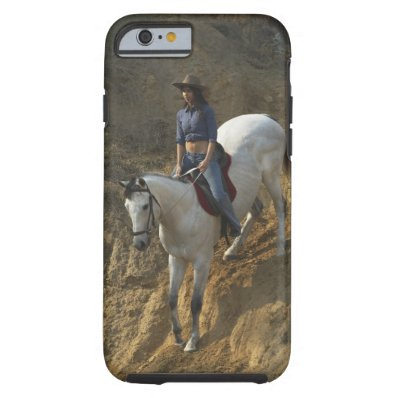 High angle view of a young woman riding a horse tough iPhone 6 case