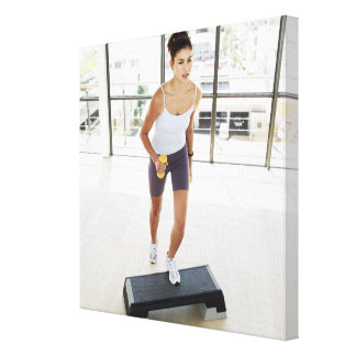 High angle view of a young woman working out on canvas print
