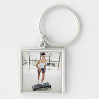 High angle view of a young woman working out on keychain