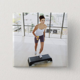 High angle view of a young woman working out on pinback button