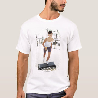 High angle view of a young woman working out on T-Shirt