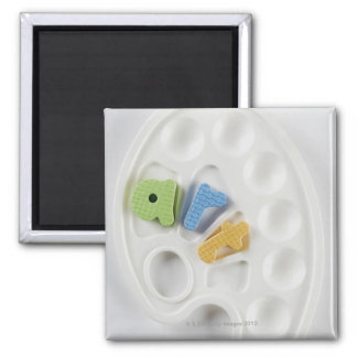 High angle view of alphabets on a palette 2 inch square magnet