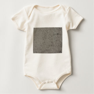 High angle view of brown ground baby bodysuit