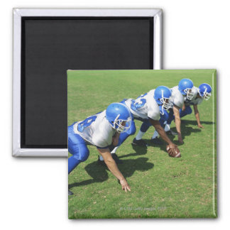 high angle view of four football players playing 2 inch square magnet