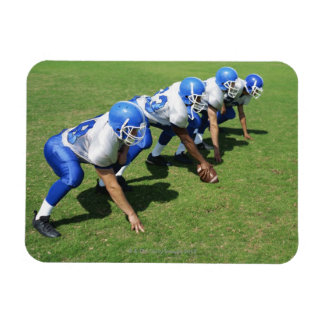 high angle view of four football players playing magnet
