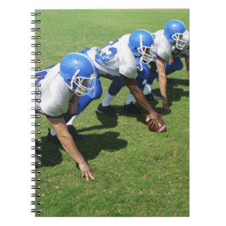 high angle view of four football players playing notebook