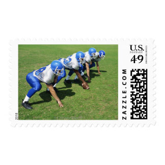high angle view of four football players playing stamps
