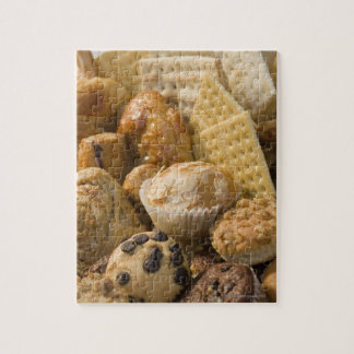 High angle view of muffins and crackers in a jigsaw puzzle