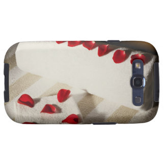 High angle view of rose petals on towels galaxy SIII covers