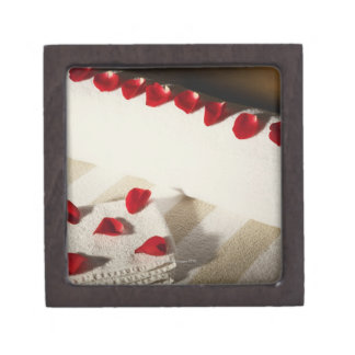 High angle view of rose petals on towels keepsake box