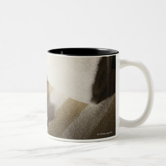 High angle view of rose petals on towels Two-Tone coffee mug