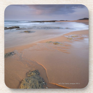 High angle view of shoreline rocks at dawn and drink coaster