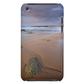 High angle view of shoreline rocks at dawn and iPod touch cover