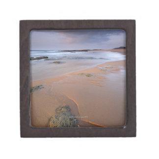 High angle view of shoreline rocks at dawn and keepsake box
