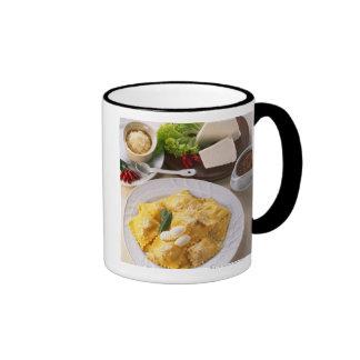 high angle view of stuffed ravioli served with mugs